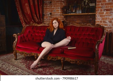 Sexual emotional redhead woman in the vintage interior
