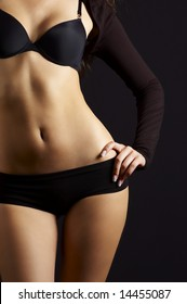 sexual feminine body in black underclothes