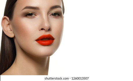 Sexual full lips. Natural gloss of lips and woman's skin. The mouth is closed. Increase in lips, cosmetology. Orange lips and long neck. Great summer mood