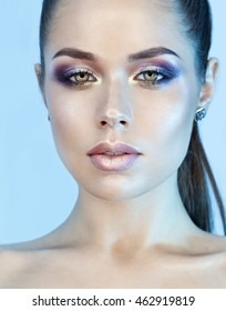 sexual girl with beautiful make up and blue reflection on the face