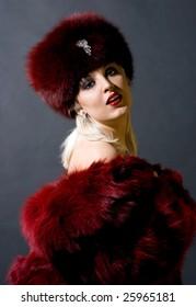sexual girl in a red fur cap