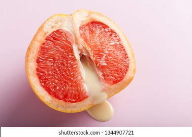 Sexual grapefruit, concept. Vagina and clitoris symbol.