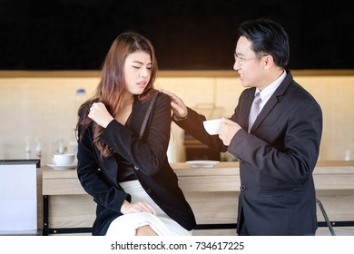 sexual harassment of businessman at work, asian Boss is touching asian female colleague/employee while drinking coffee at business office, business women is unhappy