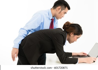 Sexual harassment in office. Young Asian business man harassing office woman sexually in modern office. For sexual harassment, assault, modern office, boss, intimidation, work ethic, stress, design.