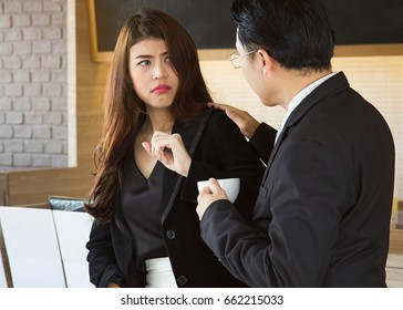Sexual harassment at work concepts. Boss / manager molesting female employee in workplace. Female is disgusting face.