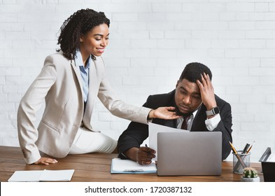 Sexual harassment at work. Lady boss molesting her male secretary in office