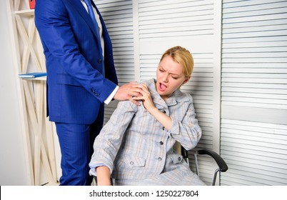 Sexual harassment at work. Person putting hand on shoulder. Man touching girl