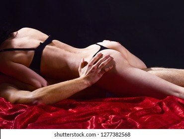 Sexual health and libido. Desire and erotic. Guide to safe sex basics. Safer sex helps you stay healthy and can even make sex better. Couple naked make love in bed. Female sexy buttocks and male body.