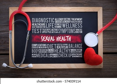 SEXUAL HEALTH word cloud on chalkboard with stethoscope, health concept.