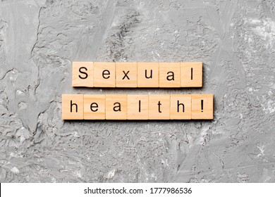 Sexual health word written on wood block. Sexual health text on table, concept.