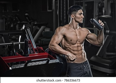 Sexual man with an idyllic figure, drinks protein from a black shaker, sports nutrition, amino acids, styrodes, creatine.