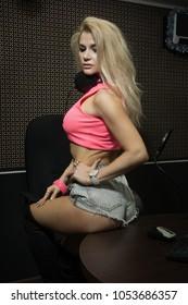 Sexual Radio DJ in the radio studio.
