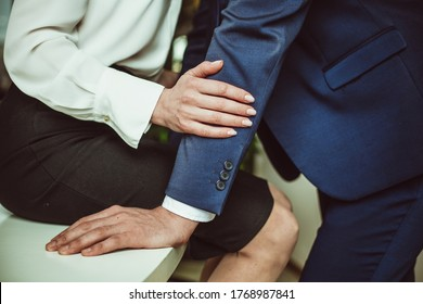 Sexual relations at work. Young business couple are having sexual activities in workplace. Woman seducing coworker or her boss at work. Passionate love affair in office.