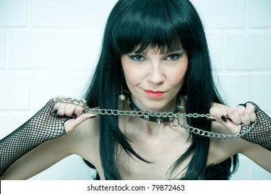 Sexual sadomaso girl with a chain, slightly toned image