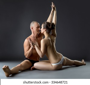 Sexual yoga. Partners posing close to each other