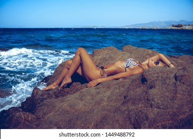 sexual young girl in the ocean posing