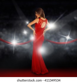 Sexual young lady on red carpet is posing in paparazzi flashes