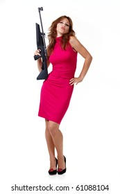 Sexy Action Girl with gun isolated over white