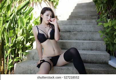 sexy asia japanese beautiful model woman lady pin up girl in black sexy elegant lingerie bikini underwear thong with black sensual kneehigh socks sit on hotel stairs sex sensual body outdoor open legs