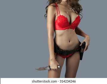 Sexy asian female model holding guns