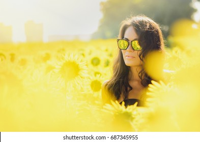 Sexy Asian girl in a field of sunflowers .