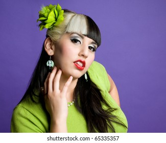 Sexy Asian girl wearing green sweater and green hair flower