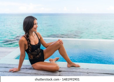 Sexy Asian swimwear black lace lingerie model woman relaxing by infinity pool beautiful body chinese beauty with smooth skin legs.