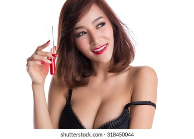 Sexy asian woman in black lingerie holding a tube, with red liquid inside, fashion, science and experiment concepts.