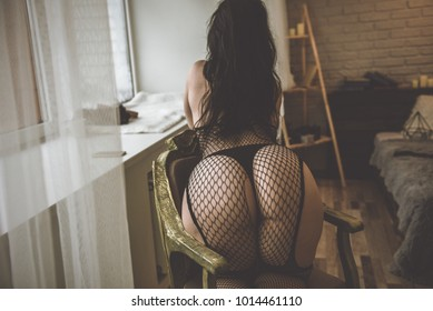 Sexy ass women. Beautiful woman wearing fishnet stockings