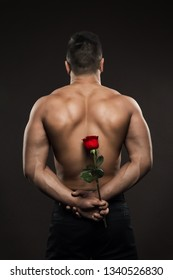 Sexy Athlete Man Back Rear view, Athletic Boy hide Rose Flower, Muscular Naked Body