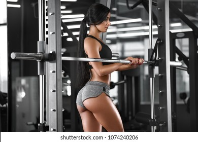Sexy athletic girl working out in gym. Fitness woman doing exercise. Sexy beautiful butt in thong