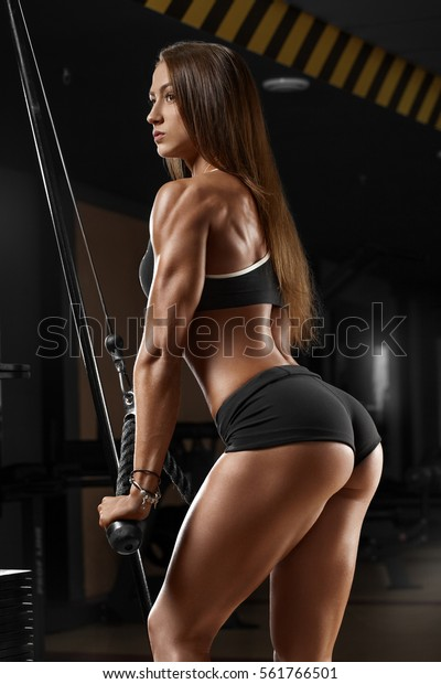 1283e897c60d Sexy athletic girl working out in gym. Fitness woman doing exercise. Sexy  beautiful butt