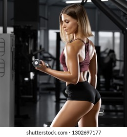 Sexy athletic girl workout in gym. Sexy buttocks in thong. Fitness woman doing exercise
