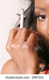 Sexy attractive black woman holding a cigarette