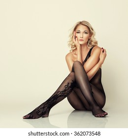 sexy attractive blond girl in stockings pose on floor