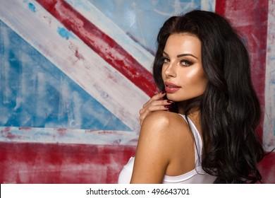 Sexy attractive brunette woman posing in studio