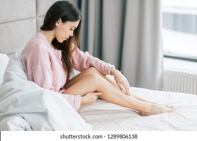 sexy awesome girl with healthy scin resting on the bed indoors . sid eview photo. beautym health care