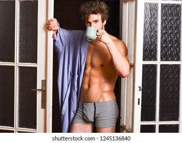 Sexy bachelor lover concept. That was great night. Guy attractive lover enjoy morning coffee. Seductive lover full of desire. Sexy macho tousled hair coming out bedroom door. Man lover near door.