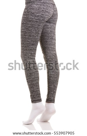 053eb2105a1 Sexy back view of fit woman legs in white socks standing on toes with one  leg