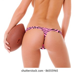 Sexy Backside of a woman holding a football wearing a pink zebra print thong