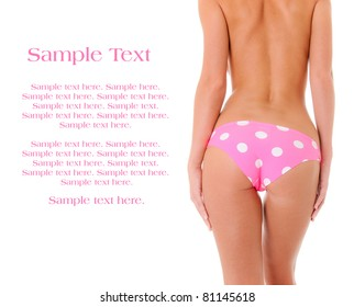 Sexy Backside of a Woman Wearing Pink Polka Dot Panties with Text Space to the Left