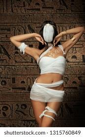 Sexy bandaged mummy woman on egypt hieroglyphs background