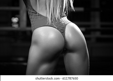 Sexy beautiful athletic ass . Beautiful athletic woman. Black-and-white photograph