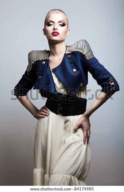 sexy beautiful blonde woman in dark blue jacket