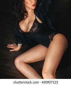 Sexy beautiful brunette girl in black underclothes
