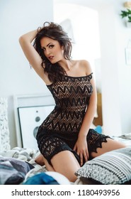 Sexy beautiful brunette woman in black underclothes