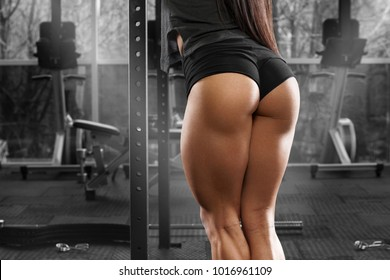 Sexy beautiful butt in thong. Fitness woman in gym