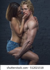 Sexy beautiful couple in love. Foreplay, sexy lovers man with woman. Young couple kissing and sexy playing.