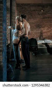 Sexy beautiful couple in a stylish loft interior