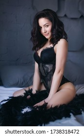 Sexy beautiful girl in black underclothes